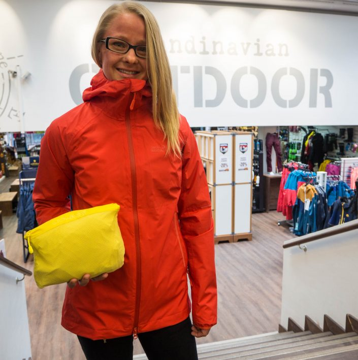 28e294c9bf1 A red version of the Jack Wolfskin Sierra Pass shell jacket and a yellow  one packed to its own pocket.